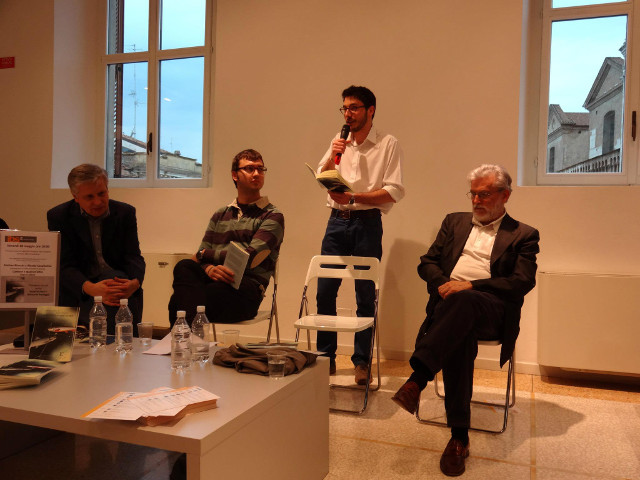 Matteo Bianchi speaks at his book launch in a bookshop in Ferrara. Others from left are: Giancarlo Pontiggia (poet), Alessio Casalicchio (book co-author) and Roberto Pazzi (novelist and poet).